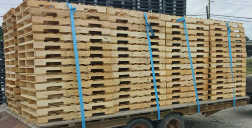 Stacks of 40 x 48 grade A recycled Pallets.