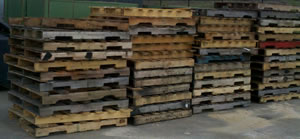 4 stacks of used wooden crates